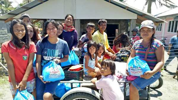 Beneficiaries in Gonzaga, Cagayan smile after receiving relief packs from Operation Sagip