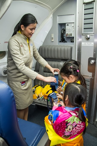 Kids learn how to be part of the Aviation Academy's cabin crew at the mezzanine floor of KidZania Manila