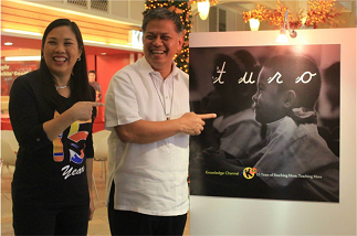 "KCFI president Rina Lopez-Bautista shares a laugh with DepEd Sec. Br. Armin Luistro when he visited the exhibit of KCFI's 15th anniversary book, ""Turo,"" in November 2014"
